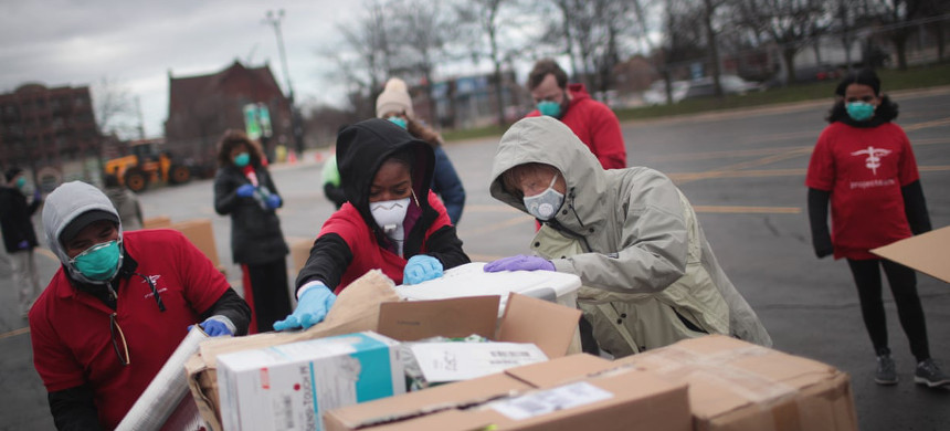 Staff and volunteers with Project Cure hold a drive to collect donations of personal protective equipment. (photo: Scott Olson/Getty)