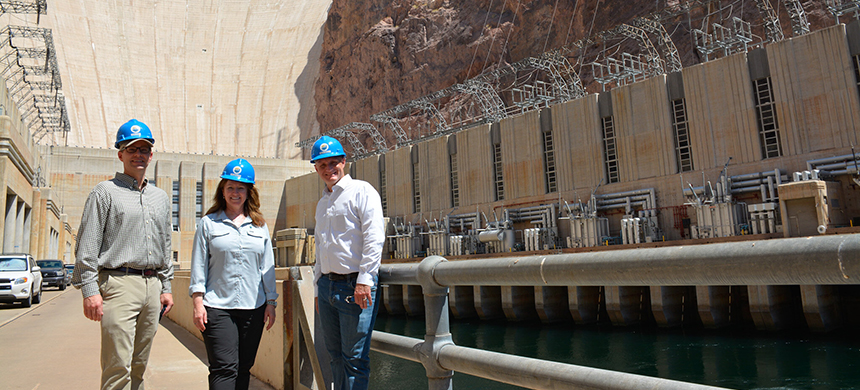 Dan Simmons, right, head of the Department of Energy's Office of Energy Efficiency and Renewable Energy, stands with reps from the U.S. Army Corps of Engineers Civil Works program and Bureau of Reclamation in front of the Hoover Dam in August. (photo: Bureau of Reclamation)