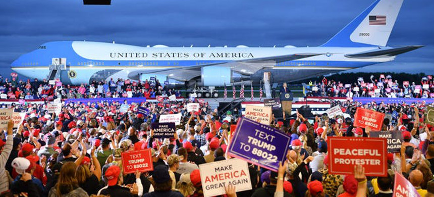 Supporters of President Donald Trump cheer during a rally MBS International Airport in Freeland, Michigan. (photo: Mandel Ngan/Getty)