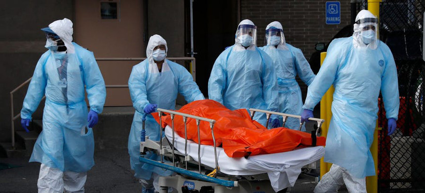 Healthcare workers wheel the body of deceased person from the Wyckoff Heights Medical Center during the outbreak of the coronavirus disease (COVID-19) in the Brooklyn borough of New York City, New York, U.S., April 2, 2020. (photo: Brendan Mcdermid/Reuters)