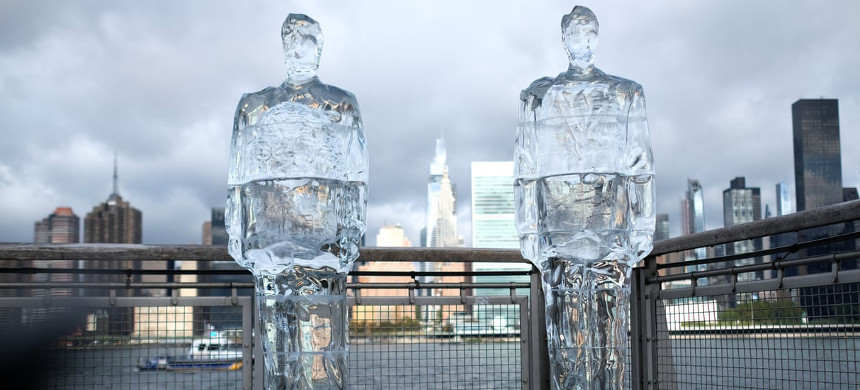 Donald Trump and Jair Bolsonaro 'Meltdown' ice sculptures in New York City. The sculptures were created to expose their absence at the UN summit on 30 September. (photo: Dimitrios Kambouris/Getty)