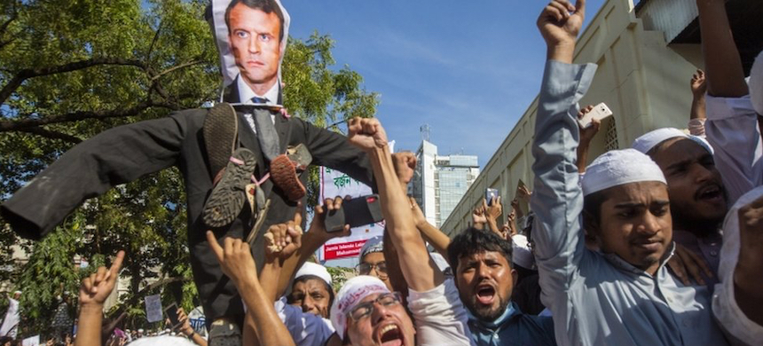 Some Muslims are furious about President Macron's defense of the right to publish cartoons of the Prophet Muhammed. (photo: EPA)