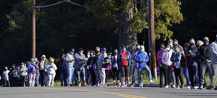 Early voters have turned out in droves, as seen at this polling location in Durham, N.C., on Oct. 15, 2020. (photo: Gerry Broome/AP)