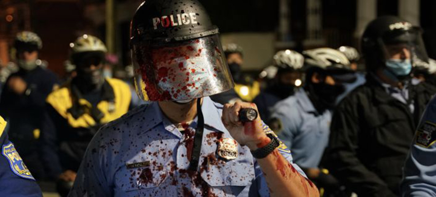 A Philadelphia police officer at a protest on October 27, 2020. (photo: Lokman Vural Elibol/Anadolu Agency/Getty Images)
