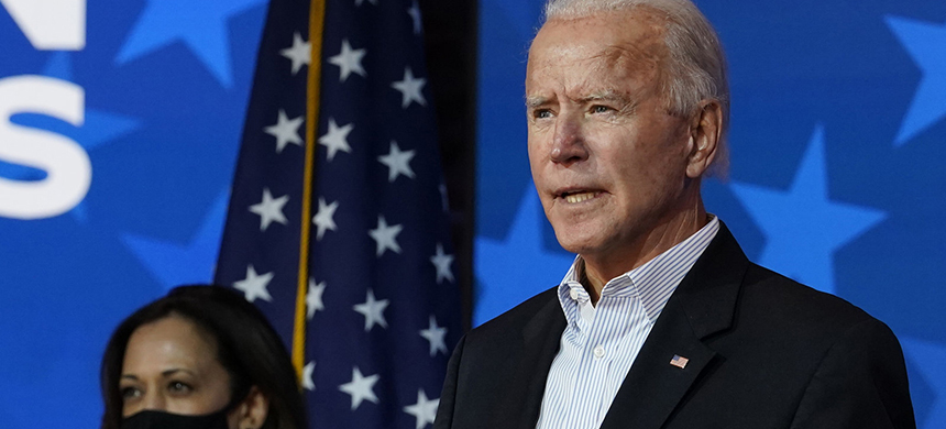President-elect Joe Biden, flanked by Vice President-elect Kamala Harris, is likely to face a divided Congress. That's something he'll need to consider as he sorts through which parts of his agenda to push first. (photo: Carolyn Kaster/AP)