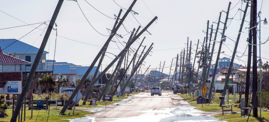 Utility poles damaged by Hurricane Zeta are seen Oct. 29 in Grand Isle, Louisiana. (photo: Bill Feig/AP)