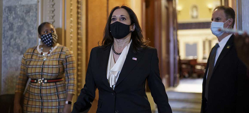 Vice President-elect Sen. Kamala Harris strides from the Senate chamber after voting against President Donald Trump's choice for the Federal Reserve Board of Governors, Judy Shelton, at the Capitol, Nov. 17, 2020. (photo: J. Scott Applewhite/AP)