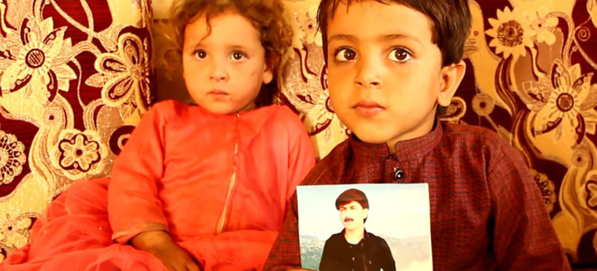 The children of the radio journalist Rahim Sekander display a photo of him in their home in Khost on Oct. 27. (photo: Foreign Policy)