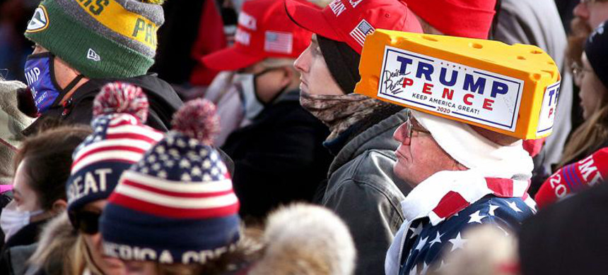 Supporters listen to President Donald Trump deliver a campaign speech at La Crosse Fairgrounds Speedway in West Salem, Wisconsin. (photo: Peter Thomson/La Crosse Tribune)