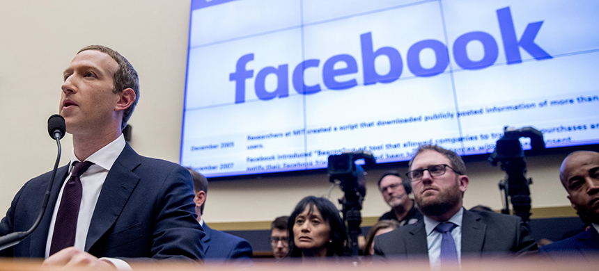 Facebook CEO Mark Zuckerberg testifies before a House Financial Services Committee hearing in 2019. (photo: Andrew Harnik/AP)