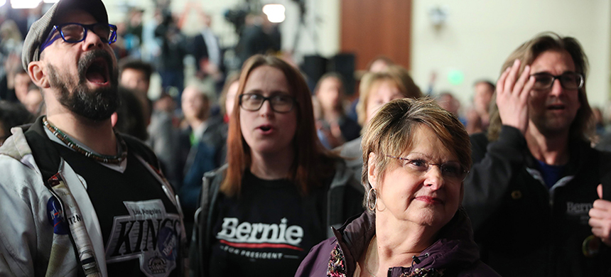 Supporters of Bernie Sanders wait for results to come in at his caucus night watch party on Feb. 3, 2020, in Des Moines, Iowa. (photo: Joe Raedle/Getty Images)