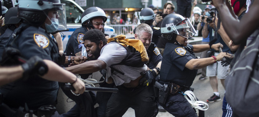 Police detain protesters as they march down the street during a solidarity rally for George Floyd, in New York on May 30, 2020. (photo: Wong Maye-E/AP)