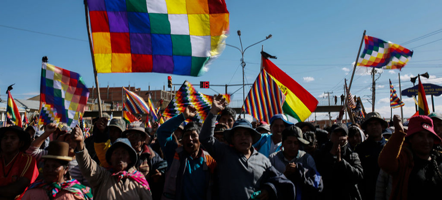 Supporters of former president Evo Morales block a road to a Yacimientos Petroliferos Fiscales Bolivianos oil refinery as part of a protest against Jeanine Áñez on November 17, 2019 in El Alto, La Paz, Bolivia. (photo: Gaston Brito Miserocchi/Getty Images)