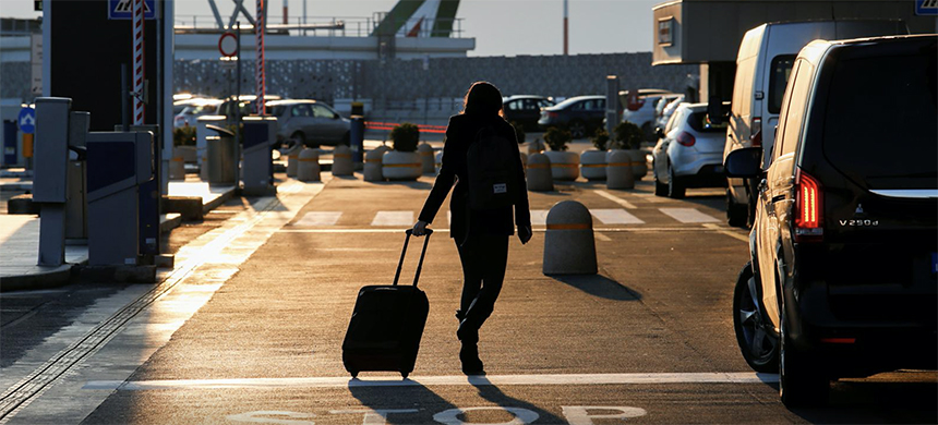 A passenger walks at Fiumicino airport after the Italian government announced all flights to and from the UK will be suspended over fears of a new strain of the coronavirus in Rome, Italy, December 20, 2020. (photo: Remo Casilli/Reuters)