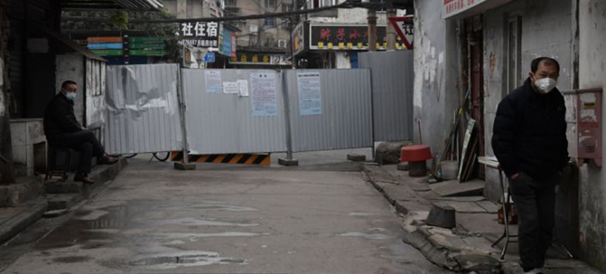 People in an alley near the Yellow Crane Tower in Wuhan, in late February. Zhang Zhan was part of a wave of journalists, professionals and amateurs, who went to Wuhan at the beginning of the pandemic. (photo: Reuters)