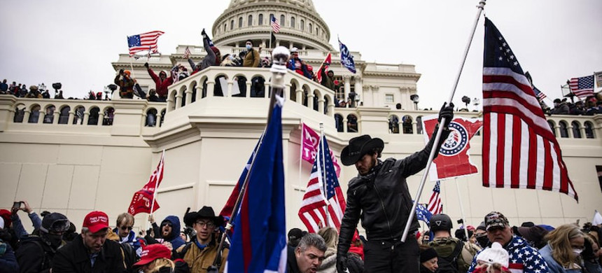 Rioters stand on the US Capitol building to protest the official election of President-elect Joe Biden on Jan. 6, 2021 in Washington DC. (photo: Thomas P. Costello/USA Today)
