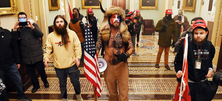 Members of Trump-supporting riot who stormed the Capitol on Jan. 6, 2021. (photo: Saul Loeb/Getty)