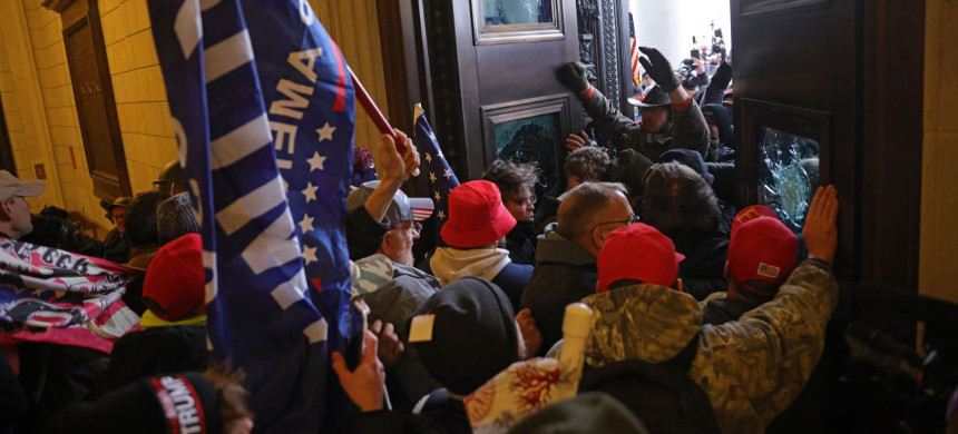 Pro-Trump protesters storm the Capitol Building, January 6. (photo: Reuters)