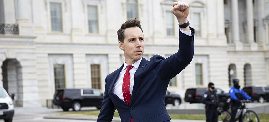 Sen. Josh Hawley, R-Mo. raises his fist toward a crowd of supporters of President Donald Trump gathered outside the Capitol on Jan. 6, 2021. (photo: Francis Chung/EE News/Politico/AP)
