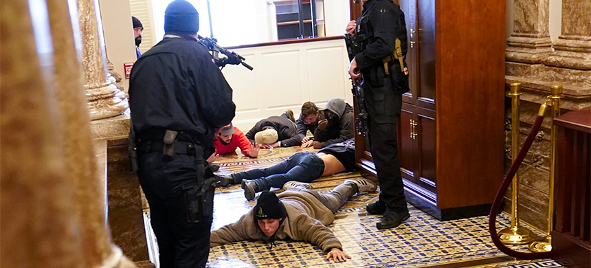 U.S. Capitol Police hold rioters at gun-point near the House Chamber inside the U.S. Capitol on Wednesday, Jan. 6, 2021, in Washington. (photo: Andrew Harnik/AP)