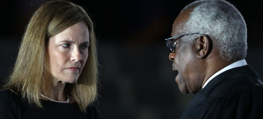 Judge Amy Coney Barrett talks with Supreme Court Associate Justice Clarence Thomas during her ceremonial swearing-in ceremony to be a US Supreme Court Associate Justice. (photo: Tasos Katopodis/Getty)