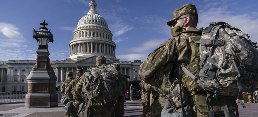 National Guard troops reinforce security around the U.S. Capitol ahead of expected protests leading up to President-elect Joe Biden's inauguration, in Washington, Sunday, Jan. 17, 2021, following the deadly attack on Congress by a mob of supporters of President Donald Trump. (photo: J. Scott Applewhite/AP)