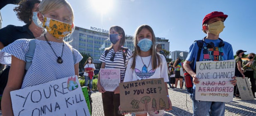 Climate campaigners in Lisbon last year. (photo: Horacio Villalobos/Getty)