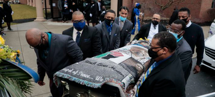 Pallbearers carry the casket of Andre Hill to a hearse following funeral services on Tuesday, Jan. 5, 2021 at First Church of God in Columbus, Ohio. (photo: Joshua A. Bickel/AP)