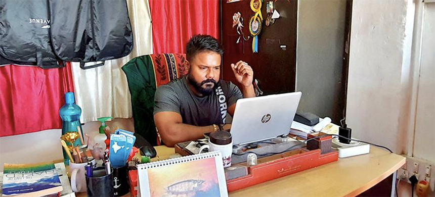 Denis Giles, editor of Indian newspaper Andaman Chronicle, works inside his office in Port Blair, the capital of Andaman and Nicobar archipelago, India, March 1, 2021. Picture taken March 1, 2021. (photo: Stringer/Reuters)
