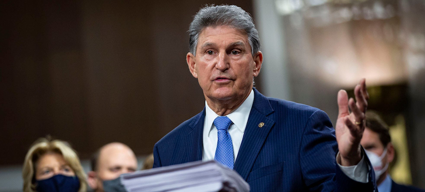 Senator Joe Manchin, a Democrat from West Virginia, speaks during a news conference with a bipartisan group of lawmakers as they announce a proposal for a Covid-19 relief bill on Capitol Hill, on Monday, December 14, 2020, in Washington, D.C. (photo: by Al Drago/WP)