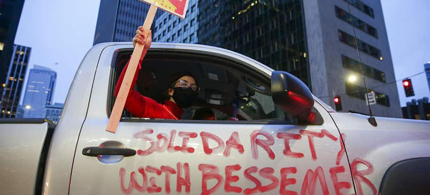 The words 'Solidarity with Bessemer' are painted on a car as demonstrators participate in a Tax Amazon car caravan and bike brigade to defend a payroll-based tax on big businesses. (photo: Jason Redmond/AFP/Getty Images)