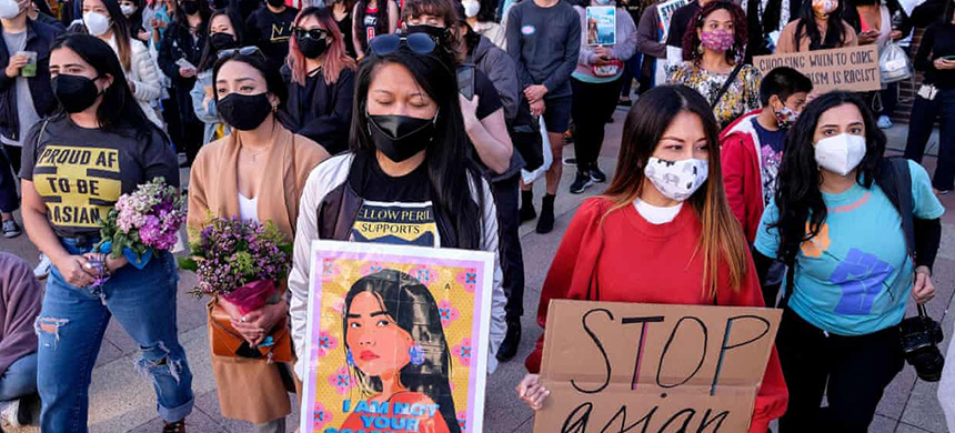 Demonstrators take part in a rally to raise awareness of anti-Asian violence in Los Angeles on 13 March. (photo: Ringo Chiu/AFP/Getty Images)