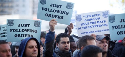 Hundreds of off-duty officers gathered on Friday at the Bronx County Hall of Justice, backing 16 colleagues in a ticket-fixing case. (photo: Kirsten Luce/NYT)
