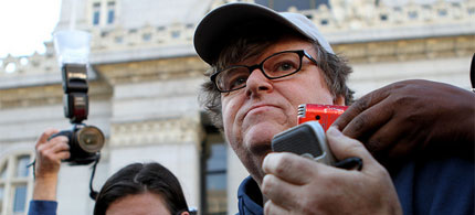 Michael Moore visited Occupy Oakland three days after the crackdown, 10/28/11. (photo: KQED News)