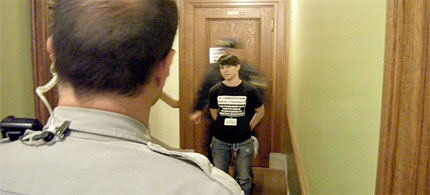 The first arrest of 18 protesters holding cameras in the Wisconsin Assembly gallery. (photo: Kristian Knutsen)