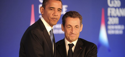 US President Barack Obama and French President Nicolas Sarkozy shake hands as they hold a joint press conference ahead of the start of the G20 Summit of Heads of State and Government in Cannes, France, 11/03/11. (photo: Getty Images)