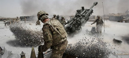 US Army soldiers fire a howitzer artillery piece in Kandahar Province, southern Afghanistan, 06/12/11. (photo: Baz Ratner/Reuters)
