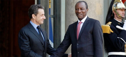 France's President Nicolas Sarkozy (left) greets Guinea President Alpha Conde at the Elysee Palace in Paris, 03/23/11. (photo: Benoit Tessier/Reuters/Landov)