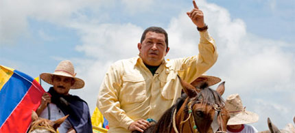 Hugo Chavez rides a horse during his weekly broadcast to his country. He has gone on television to call for judge Maria Lourdes Afiuni to be jailed. (photo: Ho New/Reuters)