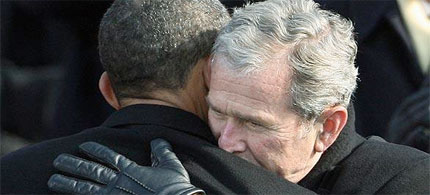 Former President Bush hugs President Obama at his inauguration. (photo: Paul J. Richards/AFP/Getty Images/Newscom)
