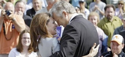 Michele and husband Marcus Bachmann on the campaign trail in Waterloo, Iowa, 06/27/11. (photo: Charlie Neibergall/AP)