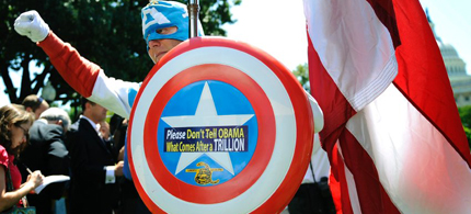 A man dressed as Captain America poses as dozens of Tea Party supporters rally against raising the debt limit in Washington, 07/27/11. (photo: Jonathan Ernst/Reuters)