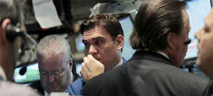 Traders on Wall Street react with concern as the markets tumble, 08/04/11. (photo: Brendan McDermid/Reuters)