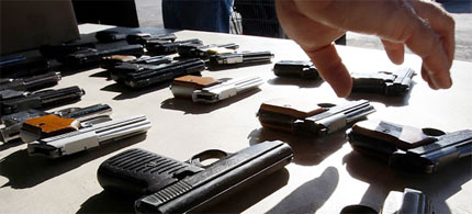 Handguns seized by the Los Angeles police. (photo: Luis Sinco/Los Angeles Times)