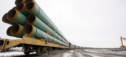 Rail cars arrive in Milton, ND, loaded with pipe for TransCanada's Keystone XL Pipeline project, which will carry crude oil across Saskatchewan and Manitoba, through North Dakota, South Dakota, Nebraska, Kansas, Missouri and Illinois, 08/26/11. (photo: Eric Hylden/Grand Forks Herald)