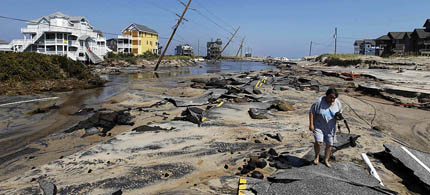 State Route 12, the main road on Cape Hatteras National Seashore in Rodanthe, NC, was severely damaged by Hurricane Irene. (photo: Jose Magana/Reuters)