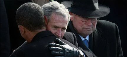 Presidents Obama and Bush embrace on Inauguration Day as Vice President Cheney looks on, 01/20/09. (photo: Justin Sullivan/Getty Images)
