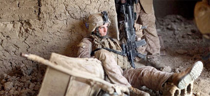A US Marine rests after a firefight in Mian Poshteh, Afghanistan, 07/19/19. (photo: Joe Raedle/Getty Images)