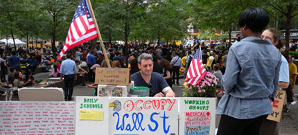 An activist works at the information desk of the OccupyWallStreet encampment at Liberty Plaza, 09/27/11. (photo: Cate Woodruff/Reader Supported News)