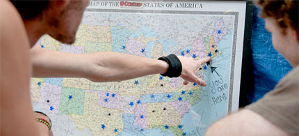 Protesters mark where marches are springing up on a map of the US. (photo: James Fassinger/Guardian UK)